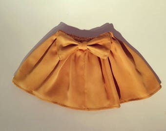 Skirt in crepe satin gold / mustard with big bow in the back. Hand made in France