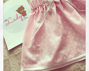 Pastel pink polka dot skirt