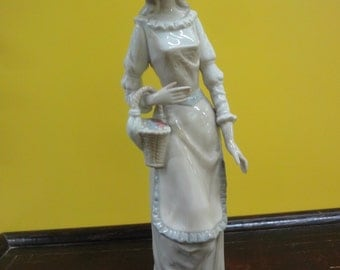 European  NADA figurine of a lady holding a basket  height =32cm