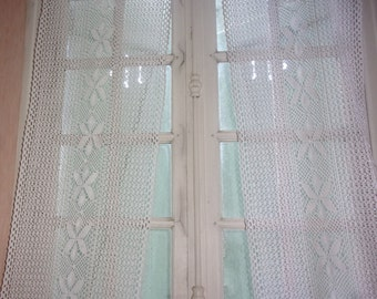 A pair of old, long curtains