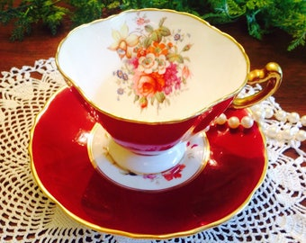 Hammersley artist signed teacup and saucer.