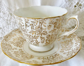 Royal Malvern Bone China Footed Teacup and Saucer Gold Floral Chintz Pattern