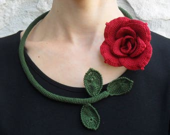 a crocheted floral necklace