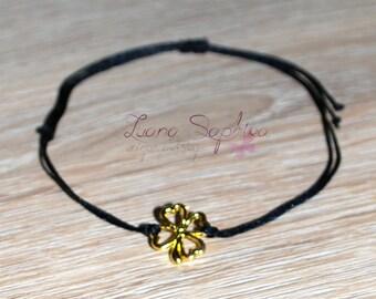 Elegant black bracelet with four-leaf clover