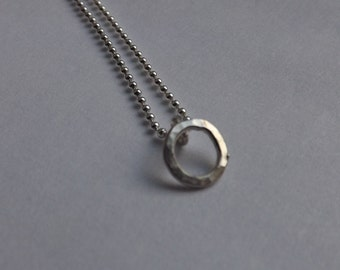 Small 5mm Silver open circle charm on necklace