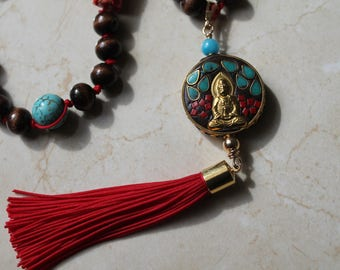 Tassel necklace with Buddha   pendant .