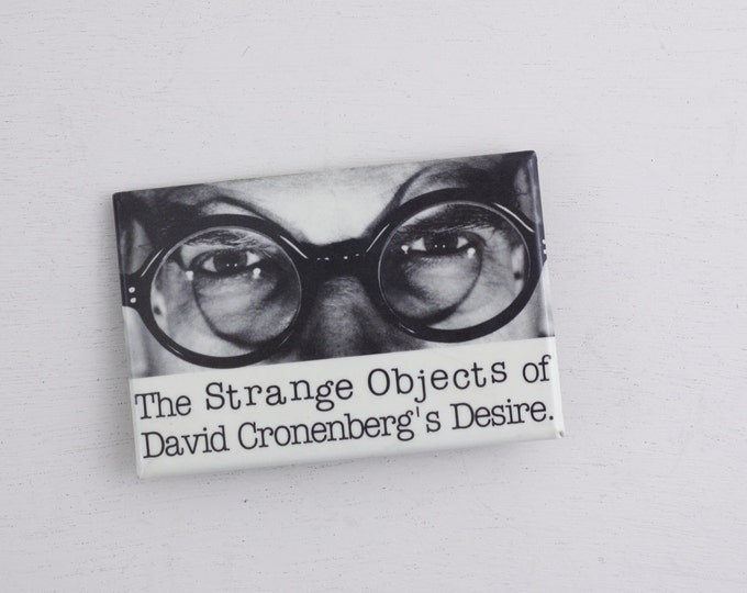Vintage pin-back art button - the strange objects of david cronenberg's desire - film maker, artist 1993 exhibition, TIFF
