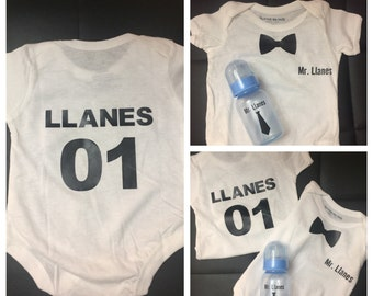 Customized onesies and baby bottle bundle.