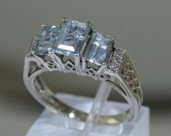 Ring white solid gold 14 K - 585/1000 aquamarine + diamonds. Size 57