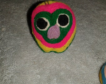 Vintage pet Rocks covered in Yarn.