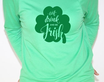 Long sleeve green t shirt with eat drink and be irish in green
