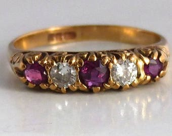 9 carat gold ring with natural rubies and diamonds