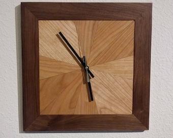 Cherry veneer starburst pattern in solid walnut frame.