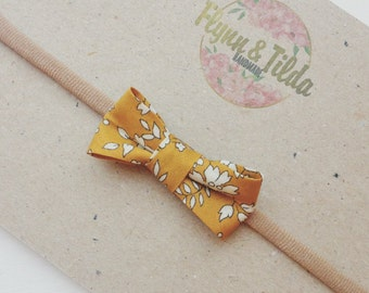 Liberty print mustard bow on baby headband or alligator clip