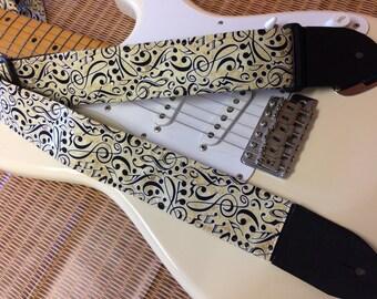 Stylish musical guitar strap -- black musical symbols on a cream background