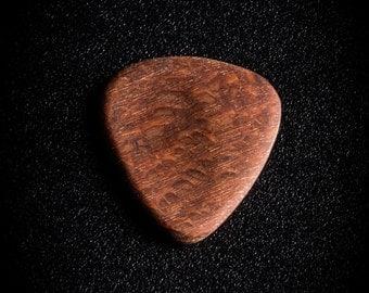 Leopard wood sideways pick
