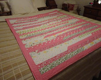 Lovely pink and pastel lap quilt or throw