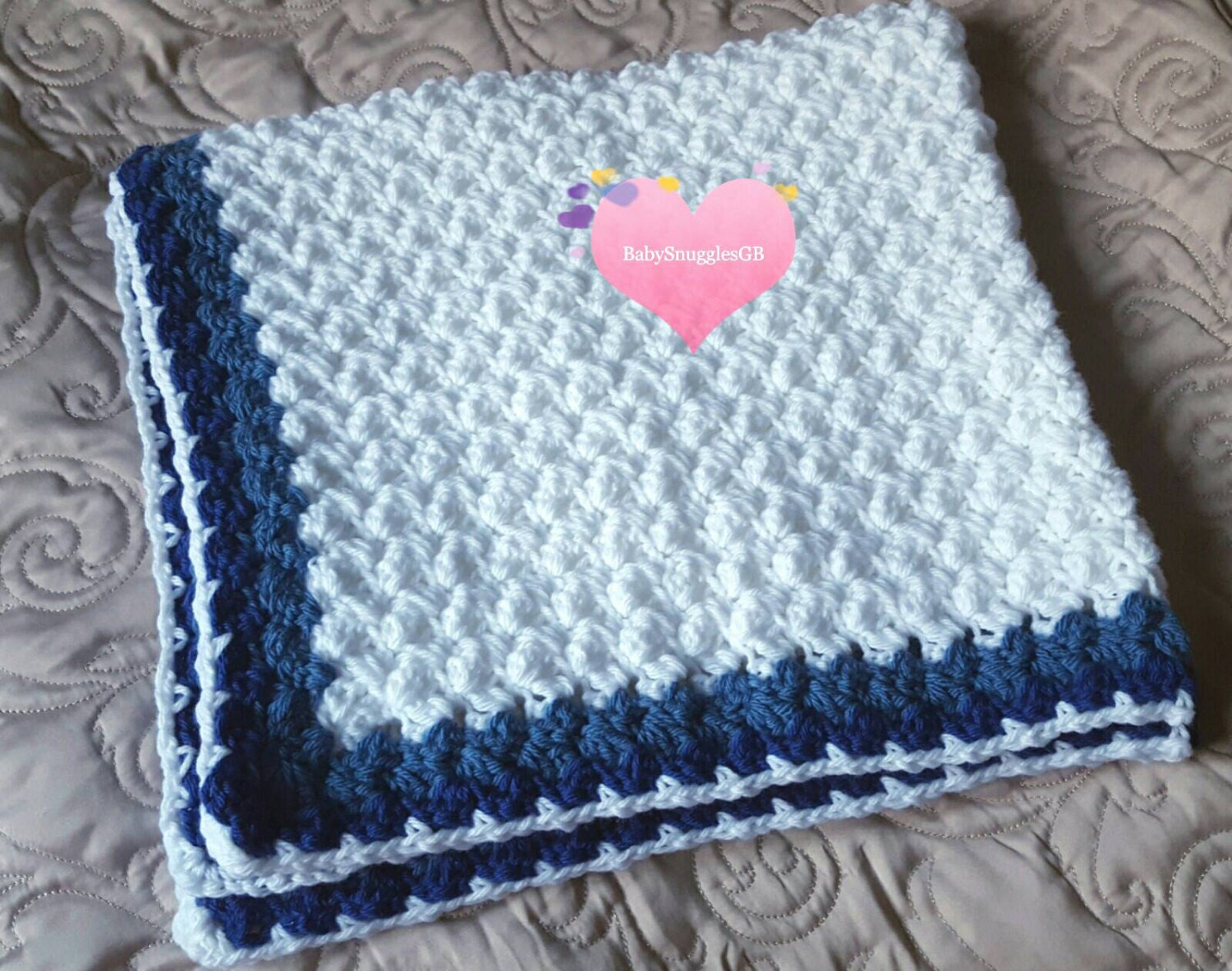 Marshmallow Crochet Baby Blanket Pattern : Crocheted marshmallow blanket in white and blue.