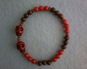 Red and Brown Beaded Bracelet with Skulls