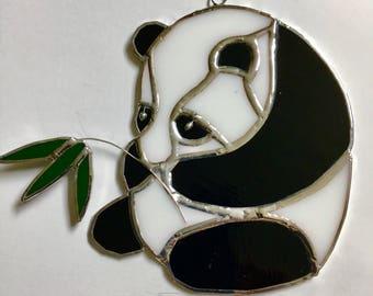 Stained glass  panda bear with bamboo shoot suncatcher.