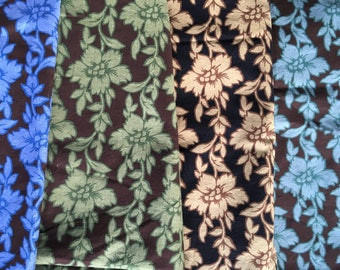 Quilting 100% Cotton 4 color ways of floral vines.  6 3/4 yds total.  Interesting print!