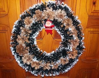 Wreath from cones with garlands and Santa Claus-handmade