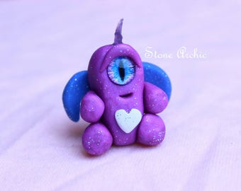 Tiny purple people eater with a raw purple amethyst horn