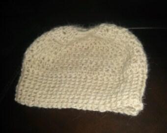 crocheted alpaca messy bun hat