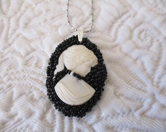 Oval Pendant embroidered with pearls