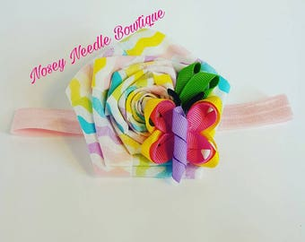Butterfly ribbon sculpture rolled rose headband.