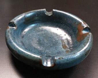 Handmade ceramic ashtray covered with metallic enamel.
