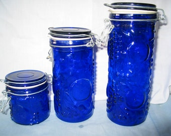 Cobalt Blue Glass Storage Containers with flip top lid. Set of 3 including large, med, and small containers.