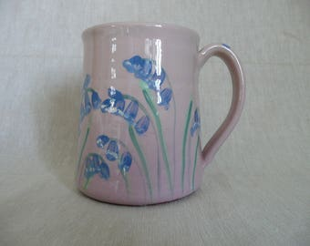 Handmade pottery bluebell mug in lilac with an apple green interior