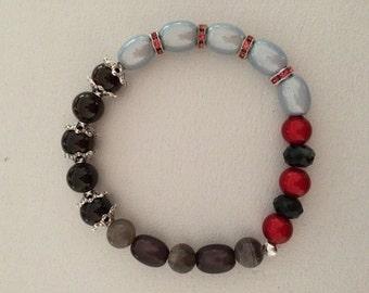 Grey, white, black, red bracelet.