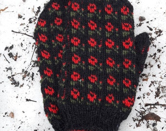 Red roses on black knitted glove