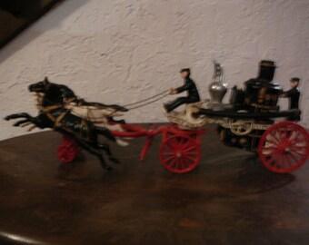 Cast iron horse drawn steam fire engine pumper