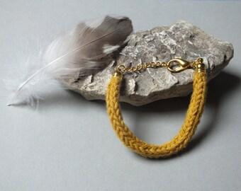 Mustard yellow knitting wool and brass bracelet
