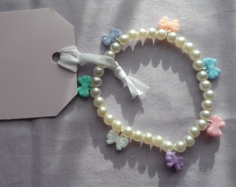 Small pearl charm bracelet with pastel bows, lolita, gyaru, girly, pink, blue, peach,lilac,mint,white,purple. Womens, girls, jewellery.