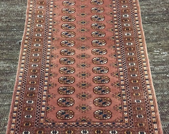 Stunning hand knotted Bokhara wool rug