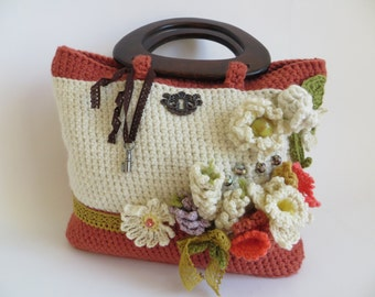 Handcrafted knitted handbag with wooden handles