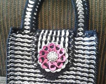 Small handbag made with soda tabs