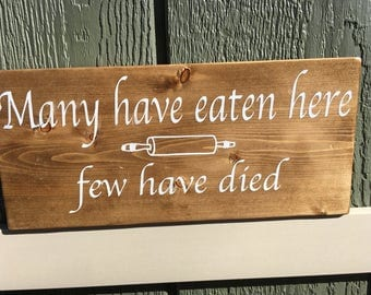 """Wood sign - """"Many have eaten here, few have died"""""""