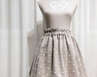 Smerlettato polka dot skirt with lace detail.