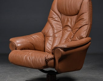 Danish brown leather swivel chair