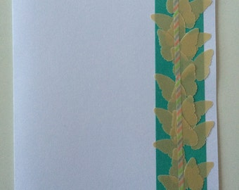 Handmade greeting card with gold butterflies