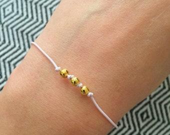 Bracelet with adjustable light pink elastic and Golden balls