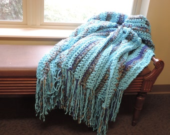super soft blue and tan crochet throw.