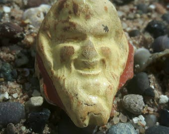 Really unique sea worn pottery raised face
