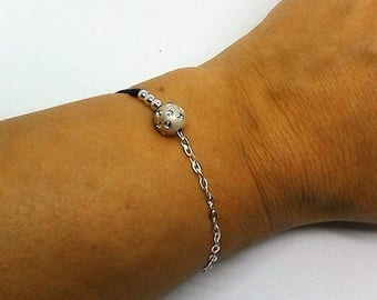 silver bracelet and cord