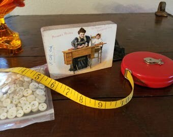 Vintage Sewing Materials Measuring Tape, Buttons, and Singer Ad Block